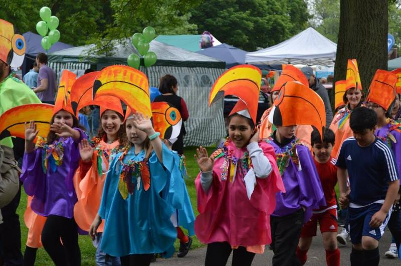 Toucan play at that game! Our artists work with children to make costumes for parades ...